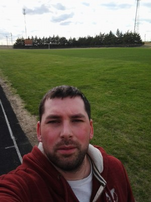 The author at one of his favourite places to write - a local football field in his town of Hill City, Kansas.