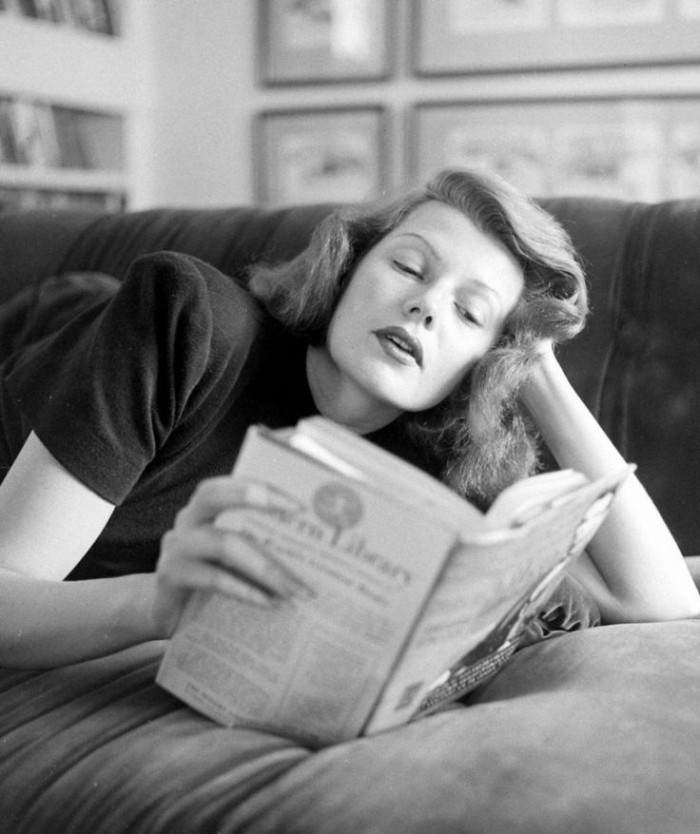 Rita Hayworth relaxing with a good book